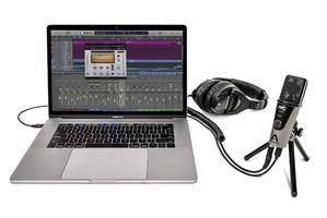 Apogee MiC Plus 3 Quarters Facing Left MacBookPro Headphones Tripod