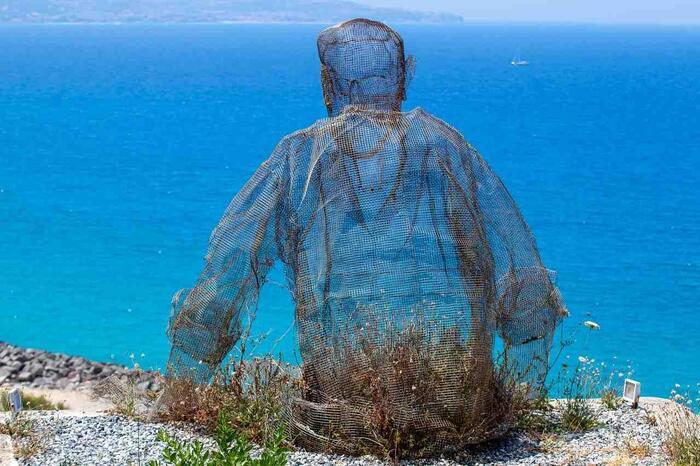 Man-overlooking-water-Tresoldi