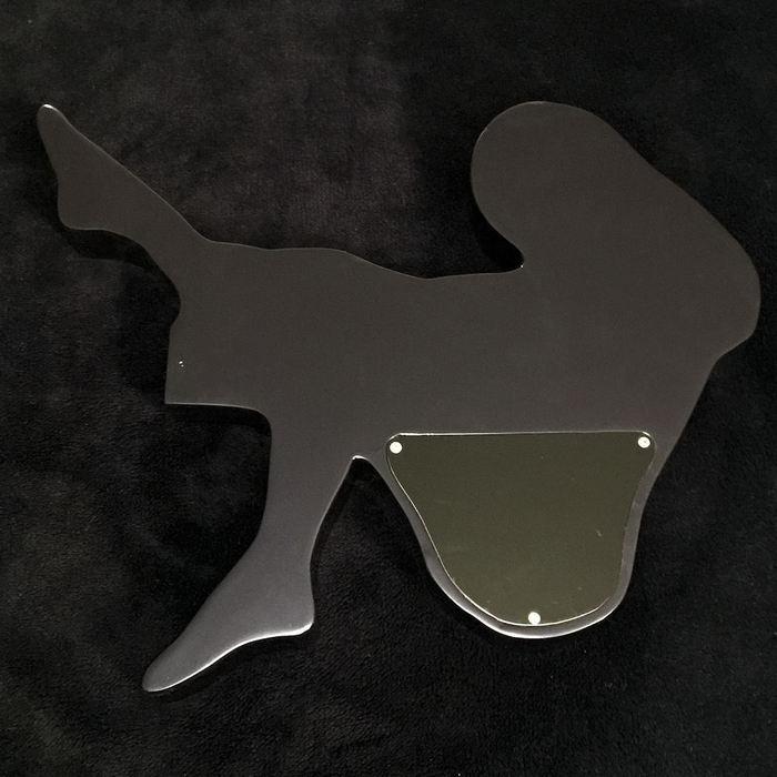 woman shaped guitar body back
