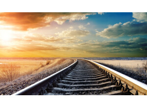 colorful-sky-over-long-train-tracks